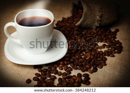 mug of coffee and coffee beans - stock photo