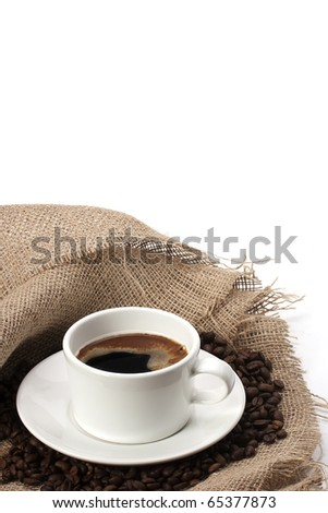 mug of coffee beans and hessian - stock photo