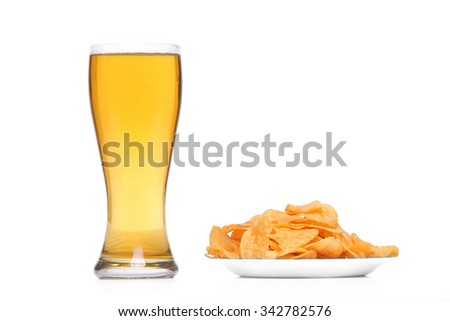 Mug of Fresh Beer and Potato chips in plate  - stock photo
