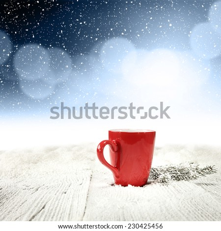 mug of red color and winter blue space  - stock photo