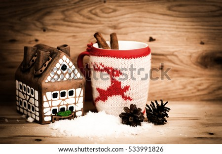 Mug Of Tea Or Coffee. Gift with red ribbon and . Sweets And Spices. Christmas Decorations. Wooden Background.
