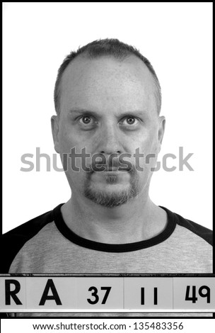 Mug shot, A fake set up booking photograph. - stock photo