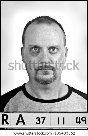Mug shot, A fake set up booking photograph this version is with a black eye - stock photo