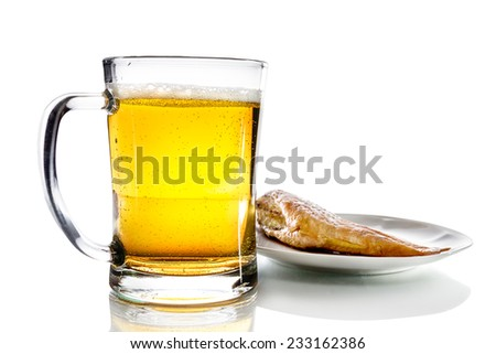 Mug with beer and fish on a plate isolated on white background