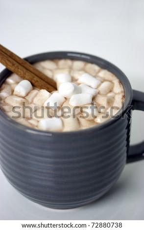 mug with hot chocolate, marshmallows and cinnamon stick. - stock photo