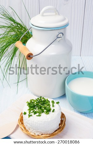 mug with milk on vintage table - stock photo