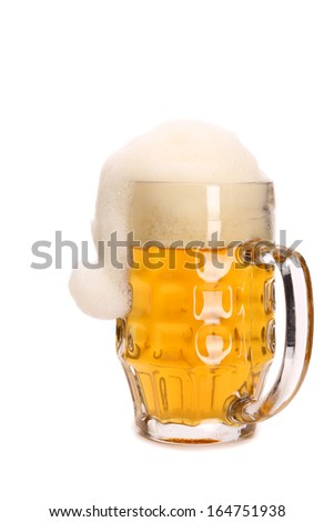 Mug woth beer and santa's hat. Isolated on a white background.