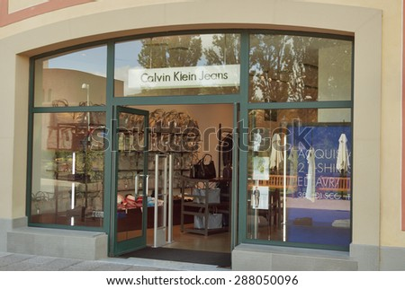 MUGELLO, ITALY - SEPTEMBER 11, 2014: Facade of Calvin Klein Jeans store in McArthurGlen Designer Outlet Barberino. Calvin Klein Inc. is an American fashion house headquartered in Manhattan, New York.