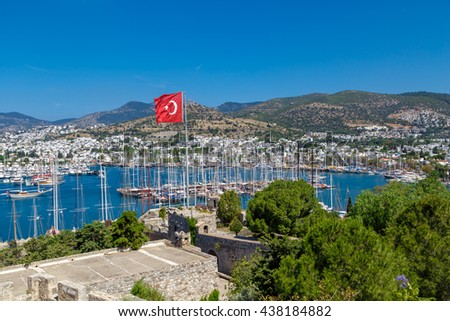 MUGLA, TURKEY - MAY 28, 2016 : Brillant landscape view of marina from historical old Bodrum Castle with stone walls on blue sky background. - stock photo