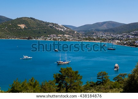 MUGLA, TURKEY - MAY28, 2016 : Seascape view of coastline with blue bright sea with small hills and small boats. - stock photo