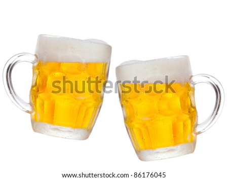 mugs of beer on white background