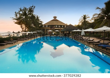 MUI NE, VIETNAM - FEBRUARY 07, 2014: Pool of a seaside resort in Mui Ne - an upcoming touristic area in Southern Vietnam