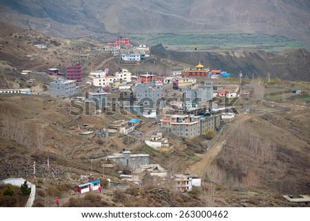 Muktinath village on a Annapurna Circuit - most popular turists trek in Himalayan mountain massive in Nepal. - stock photo