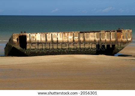 Mulberry Harbour on beach, Normandy, France - stock photo