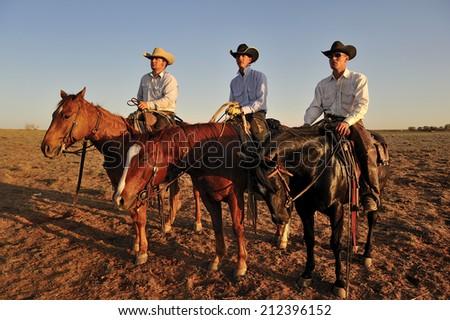 Muleshoe, Texas, USA, - March. 23. 2012: Cowboys on horses - stock photo