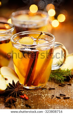 Mulled cider with aromatic spices and citrus fruits. Hot drink perfect for autumn and winter evenings - stock photo