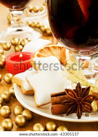 Mulled wine and gingerbread cookies with spices. Shallow dof. - stock photo