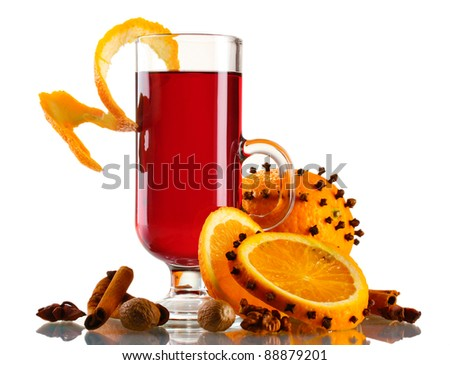 mulled wine in the glass, spice and orange isolated on white