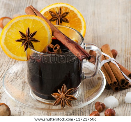 mulled wine  on a wooden table - stock photo