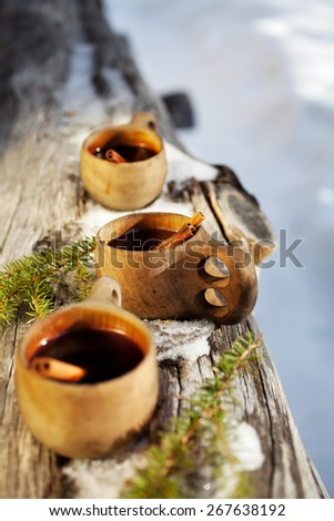 Mulled wine served from kuksa ,specially made wooden cup - stock photo