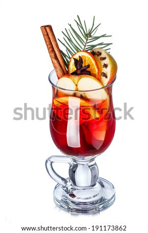 Mulled wine with apples  decorated with cinnamon stick, star anise, cloves and pine branch. Elevated view. - stock photo