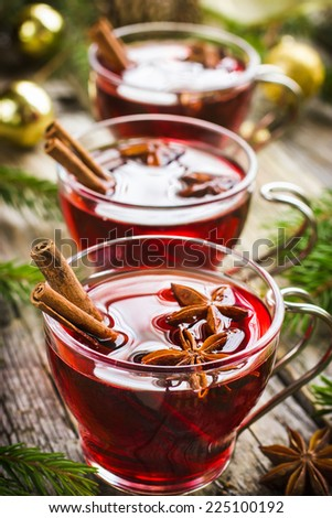 Mulled wine with cinnamon and anise stars - stock photo