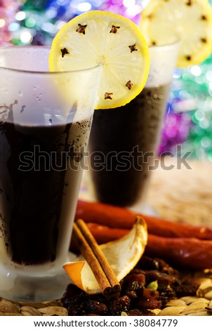 Mulled wine with lemon, cinnamon and spices
