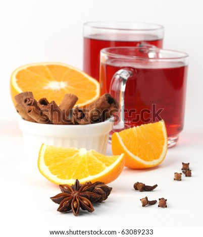 Mulled wine with oranges, cinnamon, anise and clove on white background - stock photo