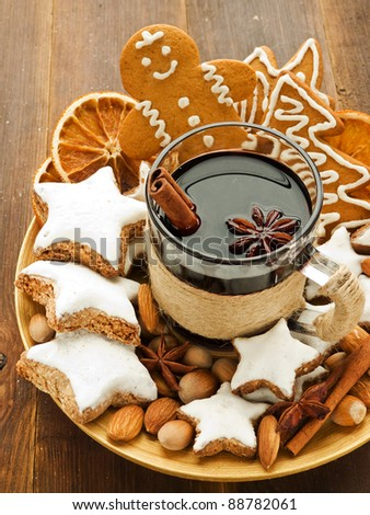 Mulled wine with spices and christmas cookies. Shallow dof.