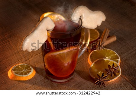 Mulled wine with spices and Christmas pastries - stock photo