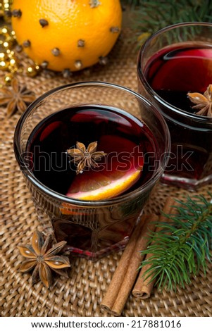 mulled wine with spices in glasses, close-up, top view, vertical