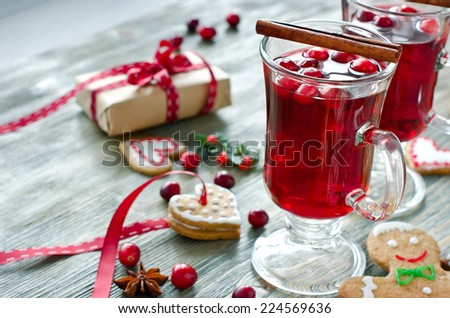 Mulled wine with spices on wooden table with christmas decorations - stock photo