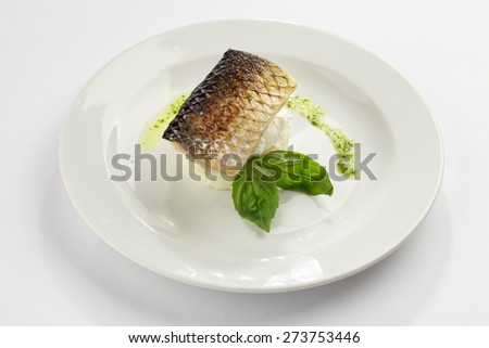 Mullet with mashed potatoes, basil and poached egg - stock photo