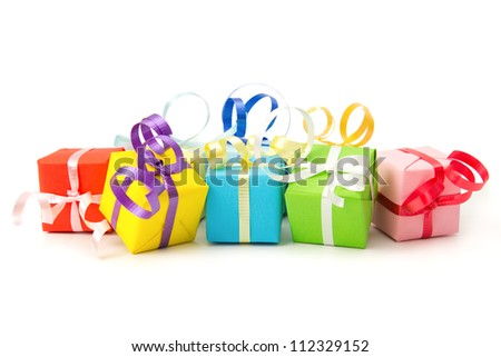 Multi color gift boxes with ribbon isolated on white background - stock photo