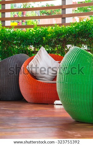 Multi color round wicker Table sets in garden./ Round wicker Table sets.  - stock photo