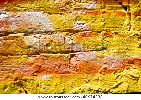 multi colored bricks in thick paint - stock photo
