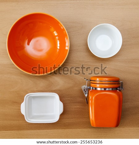 Multi-colored ceramic kitchen ware, top view - stock photo