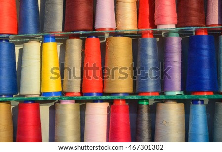 Multi-colored coils of threads in a horizontal format