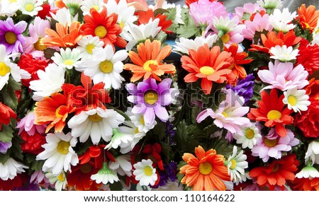 multi colored daisy flowers pattern background - stock photo