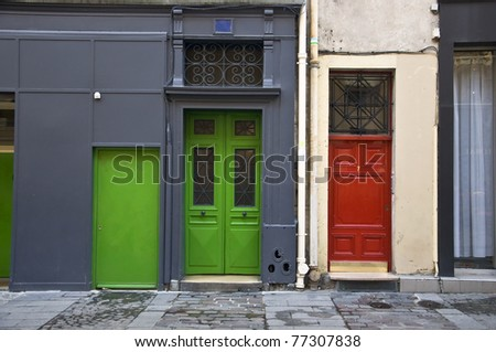 Multi-colored door. The entrance to the apartment house. Red and green doors. - stock photo