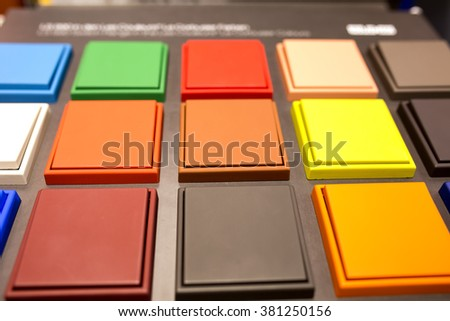 Multi-colored electrical switches - stock photo