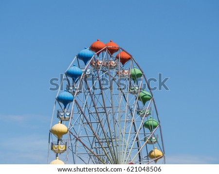 Multi-colored Ferris Wheel against the sky