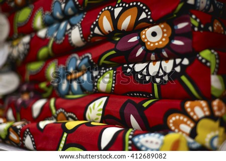 Multi colored flower pattern on patio chair cushions - stock photo