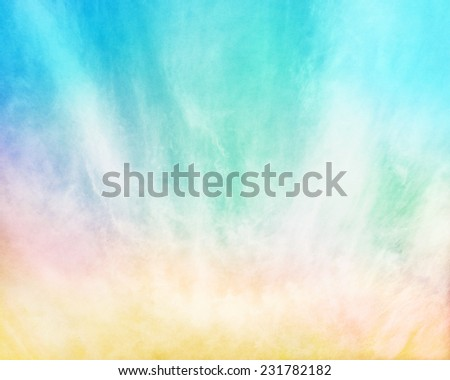 Multi-colored fog and clouds on a textured paper background.  Image displays a pleasing paper grain and texture at 100 percent. - stock photo