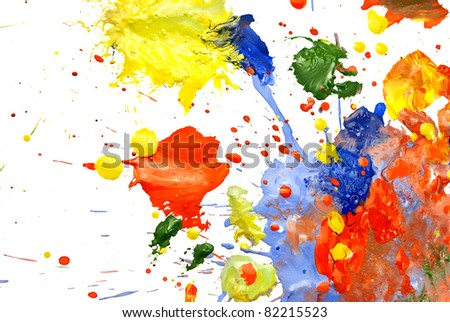 Multi-colored paint smeared randomly on a white background. - stock photo
