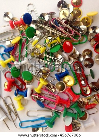 Multi-colored paper clips, pins