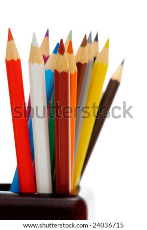 Multi-colored pencils in wood cup isolated on white background