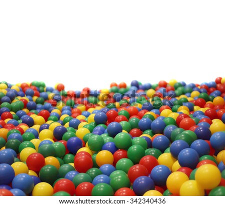 Multi-colored plastic balls. A  children's playroom.  isolated on  white background. - stock photo