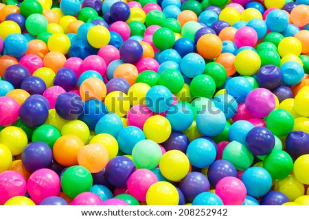 Multi-colored plastic balls colorful plastic balls on children's playground  red blue yellow bright orange plastic small - stock photo