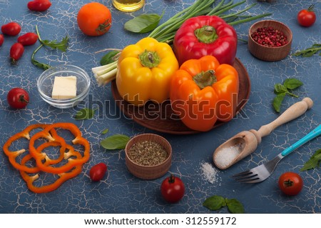 Multi-colored sweet peppers on a blue board; the substrate for the menu bars and restaurants; recipes; ingredients for cooking; healthy eating; Tips for weight loss; diet - stock photo